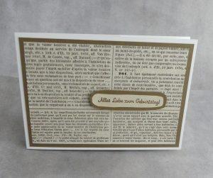 Geburtstagskarte mit Papier einer alten Buchseite