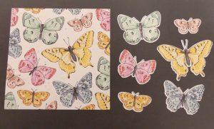 Designerpapier und ausgestanzte Schmetterlinge